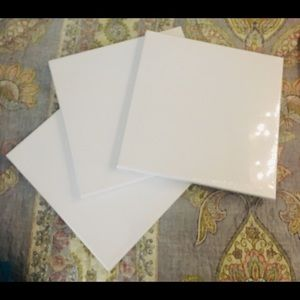 three unopened canvases